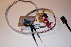 Protoboard fietspinkers: arduino pro mini, LiPo battery, NeoPixels en knoppen.